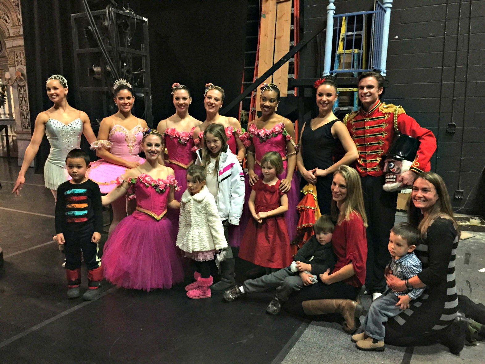 a group of kids having fun backstage at the Nutcracker with dancers from Aspen Santa Fe Ballet